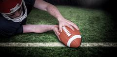 Composite image of american football player scoring a touchdown Kuvituskuvat