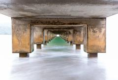 Underside of Hanalei Pier long exposure Stock Photos