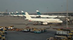 Stock Video Footage of Airplane parking at the International airport in Hong Kong.