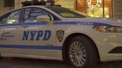 NYPD car sitting in downtown business district of New York City 4k - stock footage