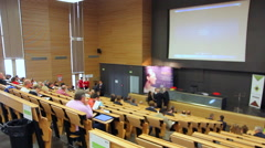 Lecture, conference in a big classroom, amphitheater - Timelapse - stock footage
