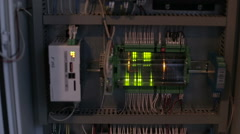 Power cable connected to a circuit breaker in the electrical cabinet Stock Footage