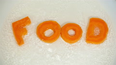 Word Food collected from letters, which are carved from carrots Stock Footage