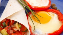 Fried eggs and tortilla with salad served on blue Stock Footage
