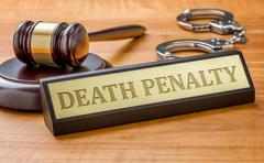 A gavel and a name plate with the engraving Death Penalty Stock Photos