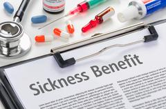 Stock Photo of Sickness Benefit written on a clipboard