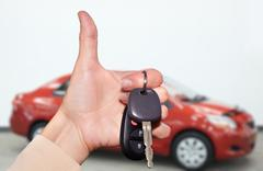 Driver hand with a car key. Stock Photos