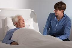 Hospice patient with a caregiver Stock Photos