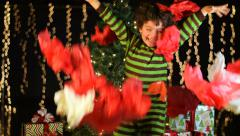 Cute Child Throws Christmas Wrapping Paper In the Air Stock Footage