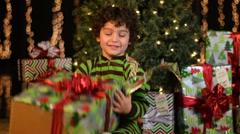 Cute Child Unwraps Christmas Present Stock Footage