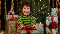Cute Child Receives Christmas Present Stock Footage