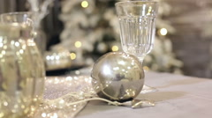 Christmas decorations in the studio. Christmas toys, ball, glasses on the table. Stock Footage