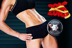 Composite image of female bodybuilder holding large black dumbbell mid section - stock photo