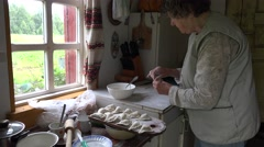 Senior woman prepare dumplings with curd in rural kitchen room. 4K Stock Footage