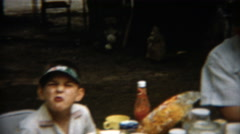 1955: Outdoor family picnic with visor hats popularly worn by young and old Stock Footage