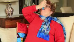 Mature woman using asthma inhaler - stock footage