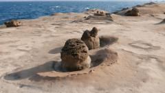 Small mushroom weathered stone at deserted Yehliu shore, parallax shot - stock footage