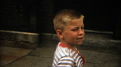 1955: Big brother calling over little brother to show him a secret. Stock Footage