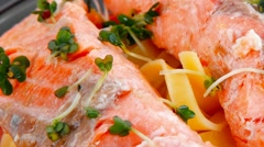 Fried natural pink salmon on italian traditional tagliatelles Stock Footage