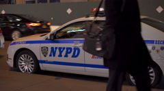 NYPD police vehicle parked curbside in city 4k Stock Footage
