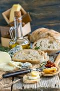 Homemade bread, cheese and olive oil. Stock Photos