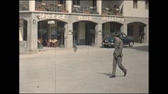 Vintage 16mm film, 1960, Austria, man in uniform walking down street Stock Footage