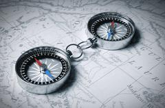 Two Linked Compass On The Map - stock photo