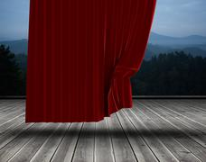 Red curtain pulling back - stock photo