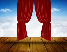 Stock Photo of Red curtain pulling back