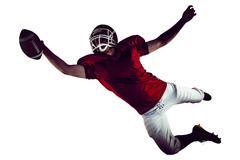 American football player scoring a touchdown Kuvituskuvat