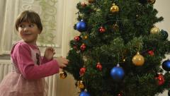 4K: Two Girls Decorated Christmas Tree - stock footage