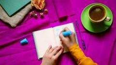 Hands writing to do list with 3 option . Top view. Purple background from above Stock Footage