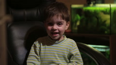 Little boy playing with toys depicting different emotions Stock Footage