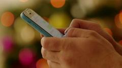 Woman Writing Seasonal Greetings in Smartphone Stock Footage