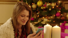 Woman Sending Seasonal Greeting Using Smartphone Stock Footage