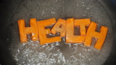 Word Health collected from letters, which are carved from carrots Stock Footage