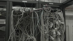 Downtilt over the chaos of internet cables - stock footage
