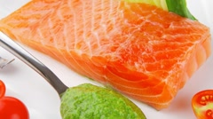 Salmon fillet with vegetables and pesto sauce Stock Footage