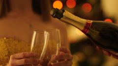 Pouring Champagne to Glasses to Toast the Christmas Stock Footage