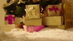Present Box in front of the Christmas Tree - stock footage