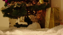 Stacking Gift Boxes by the Christmas Tree Stock Footage