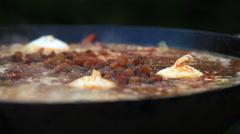 Stock Video Footage of Raisins in Pilaf Afghan, Uzbek, Tajik national cuisine dish cooking