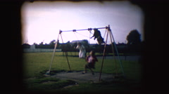 Vintage 8mm footage of children on a swing Stock Footage