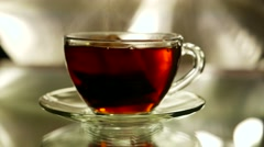 black tea in a bag brewed with boiling water in cup and saucer - stock footage