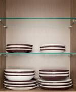 Mixed clean white and brown dishes Stock Photos