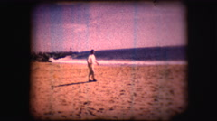 Vintage 8mm footage of a man on a California beach - stock footage