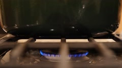 Green pot sits over a gas burner flame Stock Footage