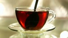 In Black tea is added the sugar and mix by teaspoon, slow motion Stock Footage
