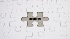 Word Association: Business & Success - on white jigsaw puzzle Stock Footage