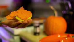 Frosting a Cookie Halloween Stock Footage